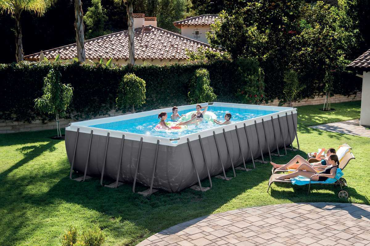 intex ultra silver frame pool 9 75 x 4 88 x 1 32 m with a safety la. Black Bedroom Furniture Sets. Home Design Ideas